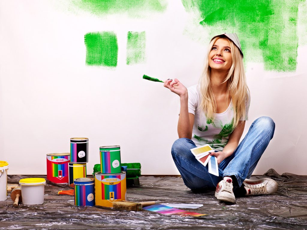 woman-paint-wall-at-home